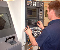 Man Operating Haas CNC Machine